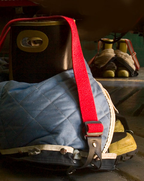 """Boots and clothes """"at ready"""" on both sides of the fire truck.  Everywhere a person would need them."""