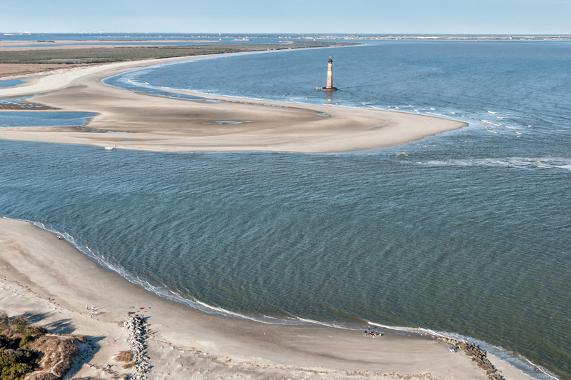 Eastern tip of Folly Beach and Morris Island Lighthouse with Sullivan's Island in the distance