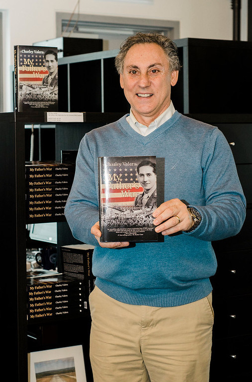 ". Charley Valera speaks with customers during a book signing at the FCA Flight Center on Saturday afternoon. Valera is the author of the new book ""My Father\'s War: Memories from Our Honored WWII Soldiers.\"" SENTINEL & ENTERPRISE / Ashley Green"
