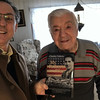 Author Charley Valera delivers a copy of his book to Fern Frechette, a local veteran featured in the book. Courtesy Photo