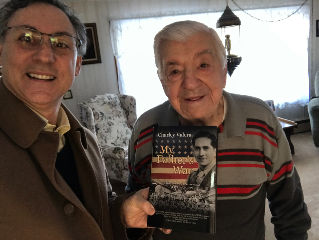 . Author Charley Valera delivers a copy of his book to Fern Frechette, a local veteran featured in the book. Courtesy Photo