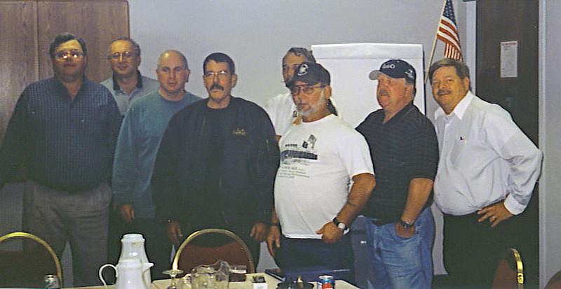 Doug Moniaci, John Georgiton, Dan Pierce, Mark Smith, Chuck Kerr hidden), Little Tex Sonnier, Mat Budziszweski, and Mike Whittaker.