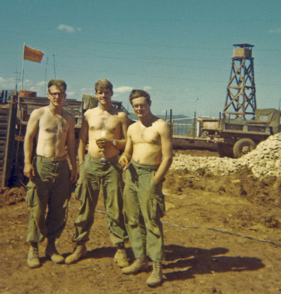 """Mike Aird, Tom Williams, and Ron """"Ringo"""" Ringeisen at Camp Carrol."""