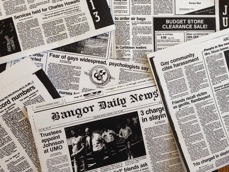 Newspaper headlines from the mid-80s show coverage of the death of Charlie Howard, the young gay man that was thrown from the Kenduskeag Stream by teenagers. Brian Feulner | BDN