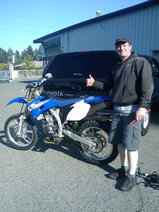 A very happy day, finally bringing home a YZ450!!  The dealer is the South Seattle Sports Plaza in Federal Way, WA.  They are the largest single line Yamaha dealer in North America.