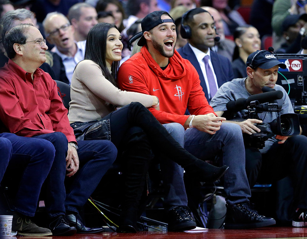 . Charlise Castro and fiance George Springer, the Houston Astros World Series MVP, watch an NBA basketball game between the Cleveland Cavaliers and Houston Rockets Thursday, Nov. 9, 2017, in Houston. (AP Photo/Michael Wyke)