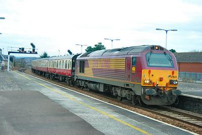 "67002 heads west through Newton Abbot on the: 1Z27 07:09 Paddington to Par ""The Eden Flyer""  13/02/10"