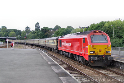 "67018 heads north through Newton Abbot on the: 1Z28 16:42 Kingswear to Bristol Temple Meads ""The Torbay Express""  09/08/10"