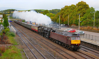 """47500 & 70000 """"Britannia"""" storm westbound through Totnes on the:  1Z92 10:24 Waterloo to Newquay """"The Atlantic Coast Express"""" 04/09/11  47500 was put on the front after 34067 Tangmere failed at Taunton and was taken off the train  Watch the video at: http://www.youtube.com/watch?v=-ryK0gqiqHs"""