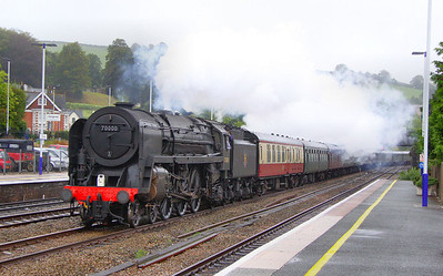 """70000 Britannia charges through Totnes in the drizzle on the: 1Z93 08:52 Newquay to Exeter St Davids """"The Atlantic Coast Express"""" 06/09/11  Watch the video at: http://www.youtube.com/watch?v=w8uU3vf4feM"""