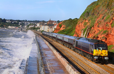 Having spent the night in Hackney Yard, Newton Abbot, 67005 leads the Royal Train with Prince Charles onboard up the Dawlish Sea Wall, passing Rockstone Bridge in rough sea's. The Train was going very slow, to allow the Prince to enjoy the views  11/09/09  Watch the video at: http://www.youtube.com/watch?v=XJi2s2smUr8