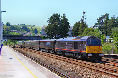 67005 leads the Royal Train north through Totnes, having left the Queen & The Duke of Edinburgh behind at Penzance to fly to the Scilly Isles. The westbound train passed Totnes at 04:30am 03/06/11  Watch the video at: http://www.youtube.com/watch?v=gC0QJOIUxtE