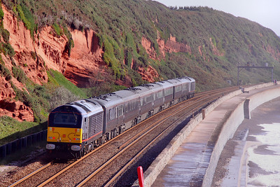 Having spent the night in Hackney Yard, Newton Abbot, 67006 on the rear of the Royal Train with Prince Charles onboard heads up the Dawlish Sea Wall, passing Rockstone Bridge in rough sea's. The Train was going very slow, to allow the Prince to enjoy the views 11/09/09  Watch the video at: http://www.youtube.com/watch?v=XJi2s2smUr8