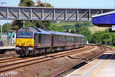 67006 on the rear of the Royal Train heads north through Totnes, having left the Queen & The Duke of Edinburgh behind at Penzance to fly to the Scilly Isles. The westbound train passed Totnes at 04:30am 03/06/11  Watch the video at: http://www.youtube.com/watch?v=gC0QJOIUxtE