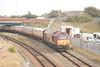 67 017 <br /> <br /> Leads <br /> <br /> UK Railtours <br /> <br /> The NatterJack <br /> <br /> 18th Sept 2014 <br /> Running as <br /> <br /> 1Z67 <br /> <br /> 07.13 Euston - Southport <br /> <br /> Eases towards <br /> <br /> Windsor Road <br /> <br /> Footbridge heading for Southport station