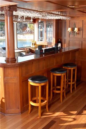 Varnished walnut bar aboard the Grand Belle of Geneva.