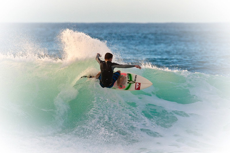 Surfing at the North Shore of Oahu, Hawaii