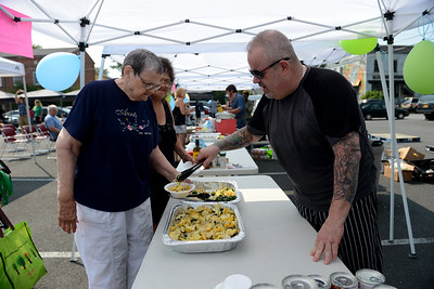 Tania Barricklo-Daily Freeman  Alleda Elllsworth, left, of Kingston , and Jamie Allen of Kingston, try a yellow squash salad from Frank Jeannetti, the first place winner of the Chef Challenge held at People's Place Tuesday morning.Jeannetti is the chef at Chopps Grille in Uptown Kingston.