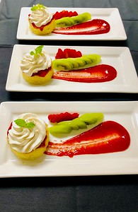Tres Leches cake, strawberry compote & sauce, cinnamon creme Chantilly