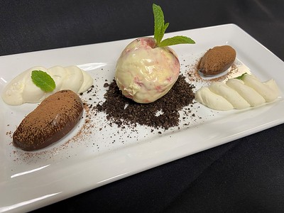 Dessert – Deconstructed cheesecake – Sweet cream cheese, oreo cookie crumb, chocolate truffles, home-made raspberry swirl ice cream