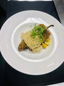 Poblano pepper stuffed with citrus & oregano braised pork, cilantro rice, sauteed petit pan squash, lime & cilantro sauce