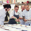 Chef Annie Pettry's team plating the main course.