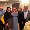 Flute player Sarah Buliszak of Chelmsford, center, with her family