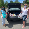 Vanna Howard of Lowell and The Z-List help collect donations.