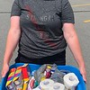 Rheanna Lanoie of Chelmsford is well-armed with supplies.