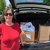 Mary Ellen Heider of Chelmsford has a trunk full of supplies.