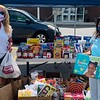 The Z-List and Vanna Howard of Lowell help collect donations.