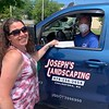 Deb Smith receives a check from Joseph Heider of Chelmsford and Joseph's Landscaping.