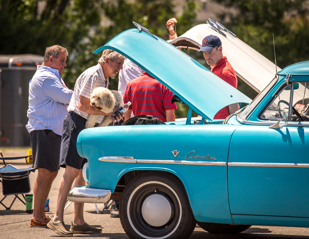 . Families and car enthusiasts look over vintage and not so vintage cars at the 3rd Annual Custom and Streetrod Car Show on Sunday at the Chelmsford Elks Lodge hosted by the Veterans Park Committee.  SUN/Scot Langdon