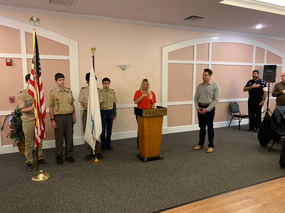 The Boys Scouts Honor Guard stand at attention for Mindy Westberry of Westford, chairwoman of the Elks' Veterans Committee and singer John Volpe of Chelmsford.