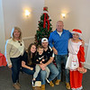 The Wolfe Family of Methuen hang with Mrs. Claus at the Elks.