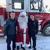 Santa arrives at the Elks with Chelmsford firefighters Dave Maher, left, and Jeff Cancella