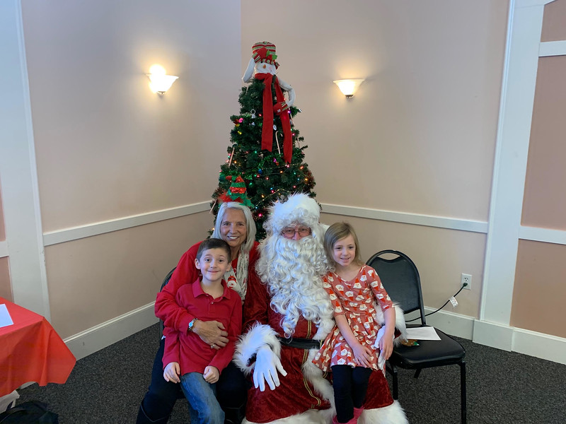 Santa with elks member Darlene Costos and her adorable grandchildren, Jonathan and Cassidy Young, all of Chelmsford