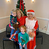 Elks member Mary Anna Leo of Littleton with grandchildren Emery and Koda Desrosiers of Leominster and Mrs. Claus