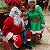 Declan Shields of Westford tells Santa and his elf, Tessa Fowler, of Billerica what he wants at the Regency.