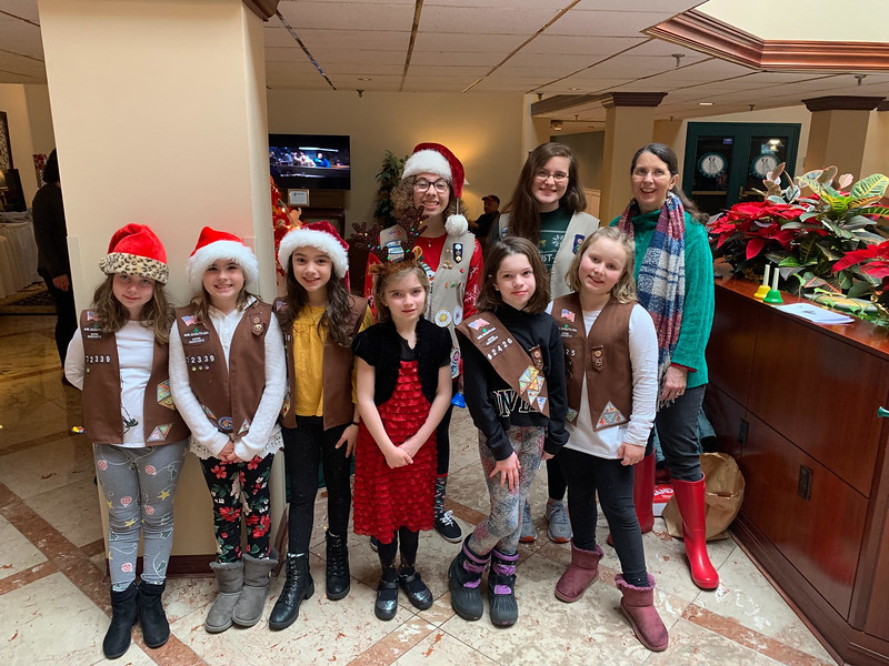 The Westford Girl Scouts helped out at the Regency.