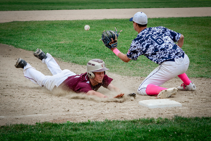Chelmsford's Derek Adamson beats Wilmington's Christopher Grecco as he slides into third base. SUN/Caley McGuane