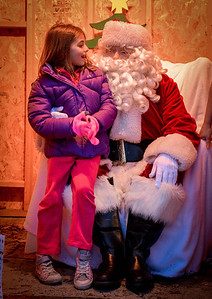 Amanda Laplaca, 7, of Chelmsford tells Santa Claus what she wants for Christmas at the Holiday Prelude in Chelmsford. SUN/Caley McGuane