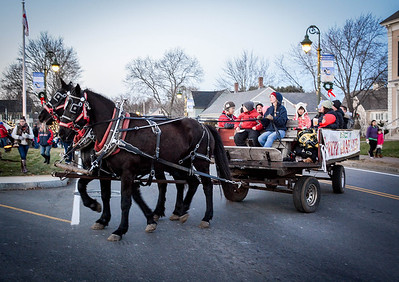 Horse drawn carriage rides are given to the public at the Holiday Prelude in Chelmsford on Sunday. SUN/Caley McGuane