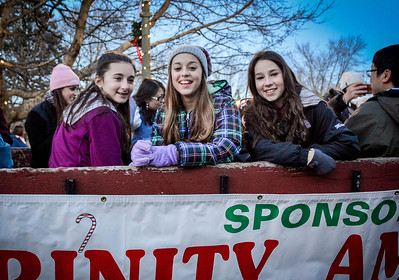 Chelmsford 7th graders from left, Kate Mason, Lyla El-Gamel, and Miranda take a ride on the horse drawn carraige at the Holiday Prelude in Chelmsford. SUN/Caley McGuane