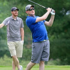 Drew Borodawka of Lowell tee's off at the Chelmsford Police Athletic League annual golf tournament at Sky Meadow Country Club in Nashua, NH. which raised about $50,000 this year. SUN/JOHN LOVE