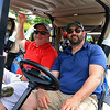 The Chelmsford Police Athletic League annual golf tournament at Sky Meadow Country Club in Nashua, NH. raised about $50,000 this year. John Judkins and Jonathan Dubois from Chelmsford wait in their golf cart for the fundraiser to start. SUN/JOHN LOVE