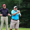 Butch Linstad, a retired police officer, watches as his teammate John Bachini reacts to his shot of the first tee at the Chelmsford Police Athletic League annual golf tournament at Sky Meadow Country Club in Nashua, NH. raised about $50,000 this year. SUN/JOHN LOVE