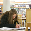 Giulia rabbito, 18, of Chelmsford and a UMass Lowell freshman works ion her calculus homework at the Chelmsford Public Library on Friday afternoon. SUN/JOHN LOVE