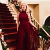 """Season sizzling in style: Merry Christmas to all! Feeling a little bit like Ginger Rogers in this cranberry chiffon overlay jumpsuit! I honor the """"stars"""" with chandelier drop earrings of gold and rhinestone stars! A cranberry pair of open-toe python like pumps! I'm ready to dance into the New Year of 2018, and I hope all of you are, too!"""