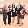 From left, emcees Jim Young and Kati Lupoli, both of Chelmsford, and the judges, Angelique Eliopoulos and Brian Reidy of Chelmsford, and Brenda Fariole of Danvers